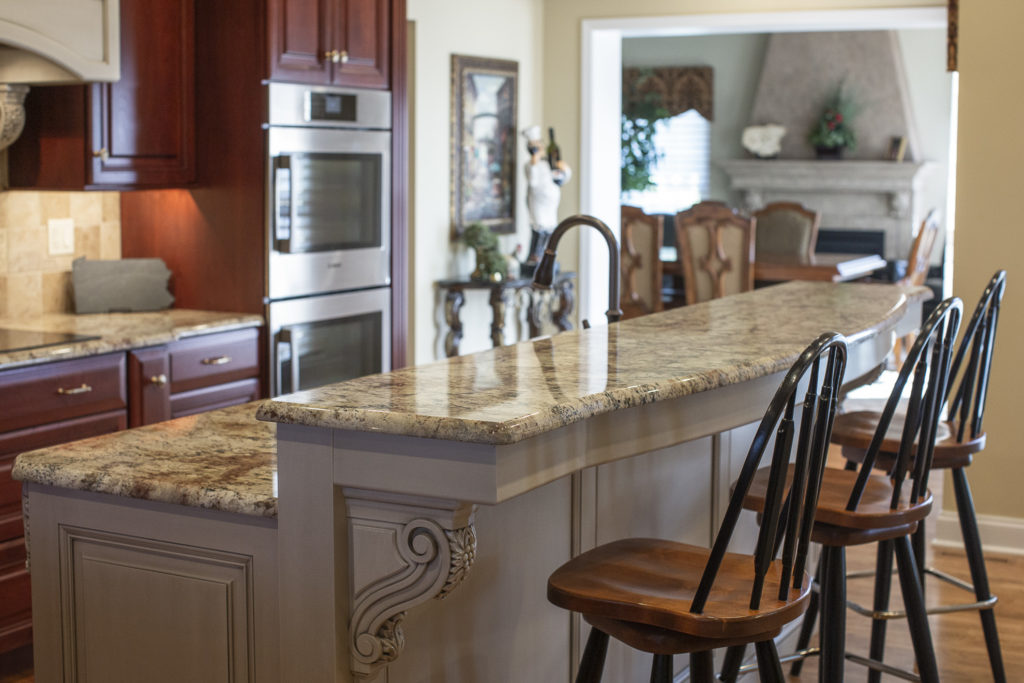 A custom kitchen island doubling as a breakfast counter.