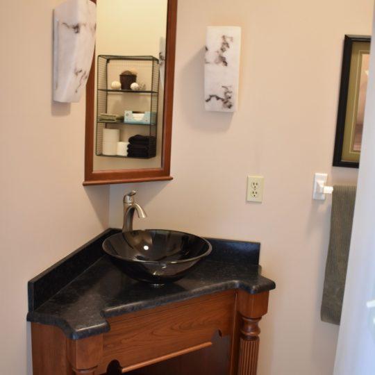 Bathroom vanity with black vessel sink